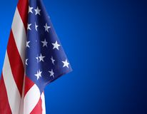 American flag and blue background. American flag in front of blue background Stock Image
