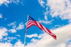 American flag on blue sky . American flag on blue sky Royalty Free Stock Photos