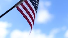 American flag on blue sky background for Memorial Day or July 4th. stock footage
