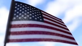 American flag on blue sky background for Memorial Day or July 4th.
