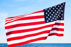 American flag on blue sky. USA Independence day, 4th July. United States flag. American flag on blue sky background. USA Independence day, 4th July. United stock photos