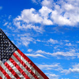 American flag with blue sky of clouds Royalty Free Stock Image