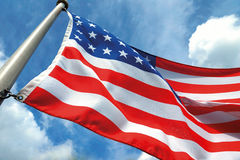 American flag on the blue sky Stock Image