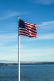 American flag with blue sky and clouds Stock Photos
