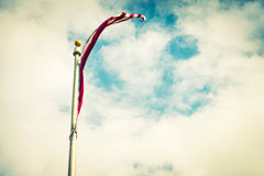 American flag on blue sky ( Filtered image processed vintage ) Stock Photography