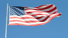 American flag isolated on blue sky, freedom stock video footage