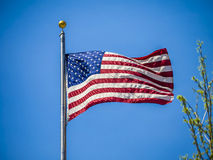 American flag on the blue sky Stock Images