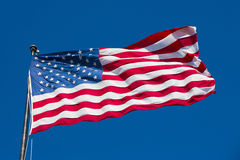 American flag on the blue sky Royalty Free Stock Image