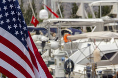 American flag on boat in marina Stock Images