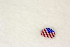 American flag bottle cap in the snow Royalty Free Stock Photo