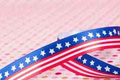 American flag bow. On a dotted background Royalty Free Stock Photography