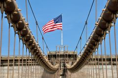 American flag on Brooklyn Bridge Royalty Free Stock Images