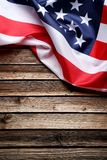 American flag. On brown wooden table royalty free stock photos