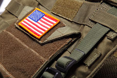 American flag on bulletproof vest. American flag on a green (olive drab) tactical vest. Close-up Royalty Free Stock Photography