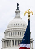 American flag and Capitol building. The American flag in front of the Capitol building in Washington DC Royalty Free Stock Photography