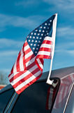 American flag on car royalty free stock photography