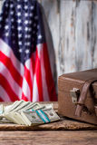 American flag, case and dollars. Royalty Free Stock Photo