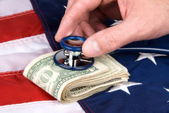 American flag and cash with stethoscope Stock Photos