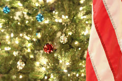 American Flag with Christmas Tree. Image of an American Flag in front of a christmas tree Stock Photos