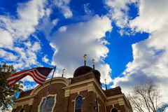 American flag and church steeple. Church sky American Flag Royalty Free Stock Photography