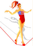 American Flag Circus. A pin-up is playing on an even keel dressing up a special American Flag Stock Photo
