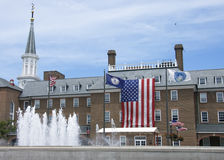 American flag and city hall building Stock Image
