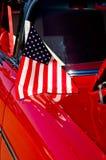 American flag on a classic car. Patriotic American flag on a classic car Royalty Free Stock Image
