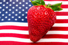 American flag close up and strawberry. American flag close up macro stars and stripes royalty free stock image