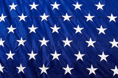 American Flag Closeup White Stars Blue Background. A close up view of the bright white stars stitched into the brilliant blue background of a colorful American royalty free stock photo
