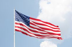American Flag and Clouds Stock Images