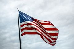 American flag with clouds in background royalty free stock photos