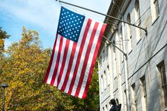 American flag on the college campus building Royalty Free Stock Photo