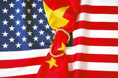 American flag. The concept of sanctions for China. Flag of China in Handcuffs on the background of the flag United States of America. USA sanctions against China royalty free stock images