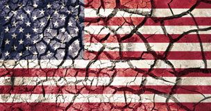 American flag on cracked ground background. Policy, crisis and collapse concept - american flag on cracked ground background royalty free stock photography