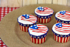 American flag cupcakes on burlap plate Royalty Free Stock Images