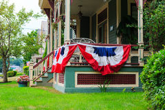 American flag decor on victorian porch. Victorian ornate home with American flag decor on the front porch on July 4, in Troy NY Royalty Free Stock Photography