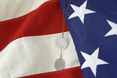 American Flag with Dog Tags #2. American flag shown with soldier's dog tags as a reminder of the sacrifice of our military for our country Royalty Free Stock Photos