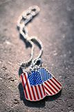 American flag dog tags background. Closeup of American flag dog tags background Royalty Free Stock Images