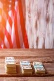 American flag and dollar bundles. Royalty Free Stock Photos