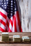 American flag and dollar bundles. Royalty Free Stock Photography