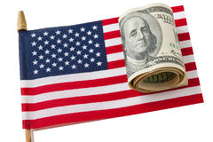 American Flag and  dollars bills. Stock Photos