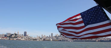 American flag downtown San Francisco by boat Royalty Free Stock Images