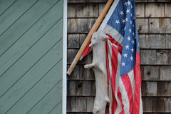 American flag draped over a piece of driftwood Stock Photography