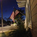 American flag at dusk. America flag shot from our porch Royalty Free Stock Photography