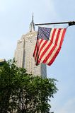 American flag with empire state background. America flag with empire state building background royalty free stock image