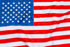 American flag fills the frame completely and fluttering. In the wind Royalty Free Stock Photos