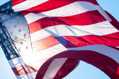 An American flag on a fire truck ladder Stock Photos