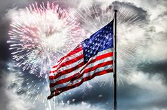 American flag with fireworks behind Royalty Free Stock Photos