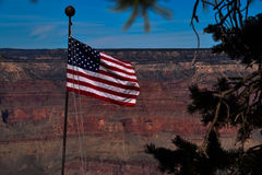 American Flag Flies Over the Grand Canyon. American Flag Flies over the cliffs and abyss of the Grand Canyon Royalty Free Stock Photography