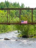 American Flag flies over an old train bridge. Royalty Free Stock Photos